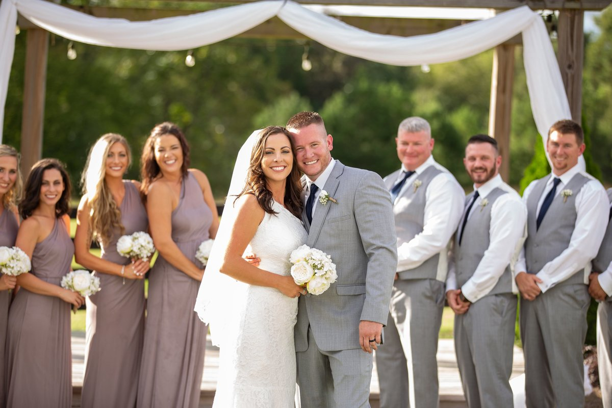 newlyweds with bridal party