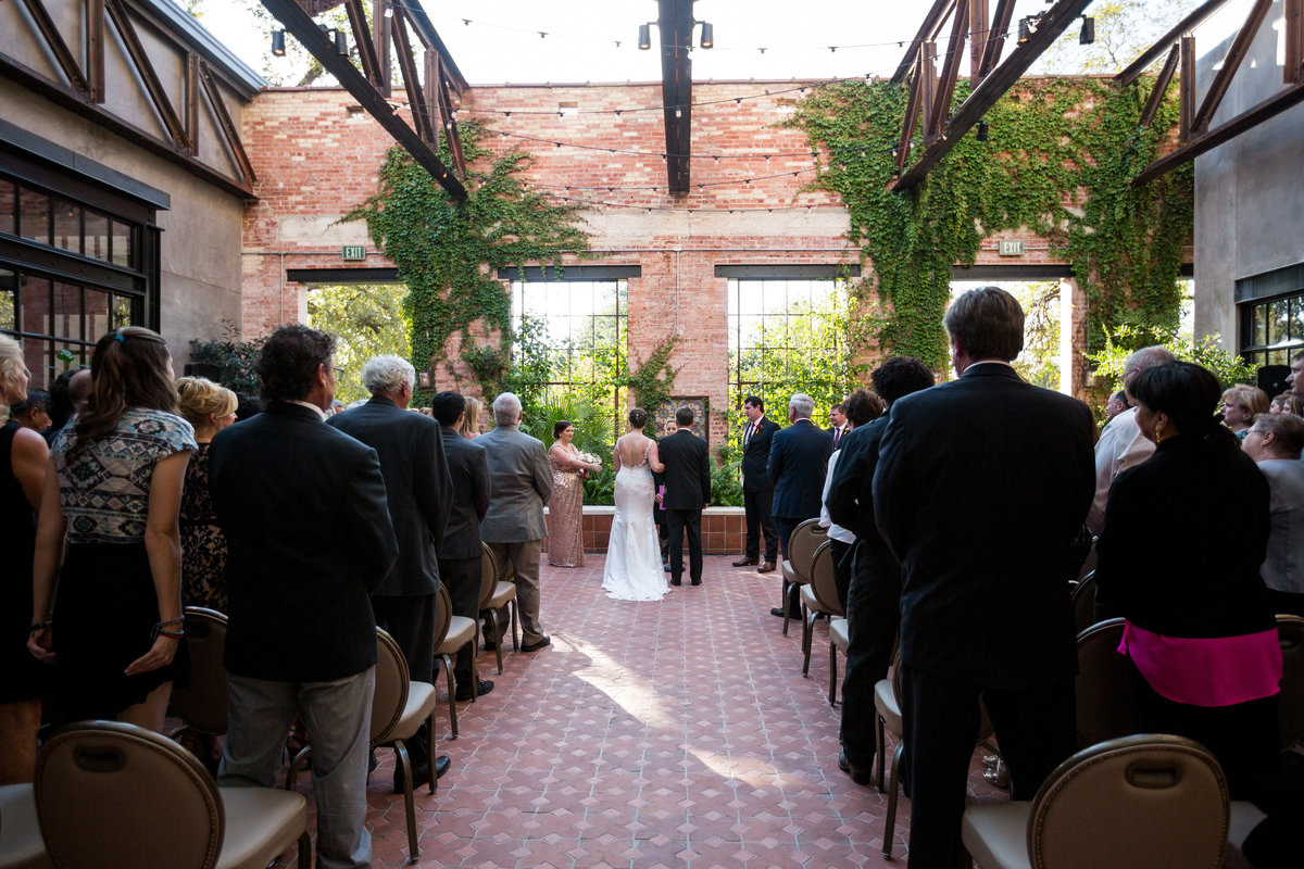 bride and groom at the Pearl brewery Wedding Ceremony at Hotel Emma outdoor wedding