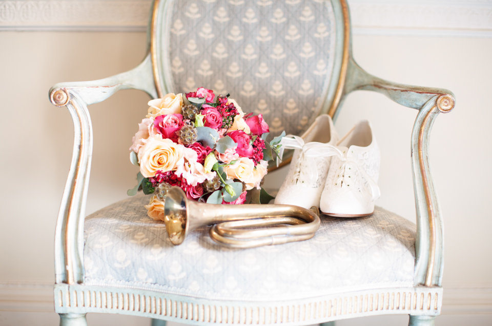 brides bouquet and shoes on a chair - BANNER