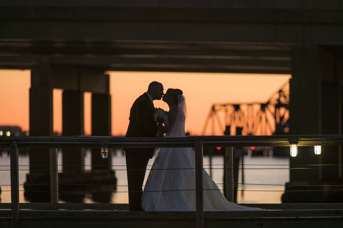 Sunset photo of the bride and groom at Bridgeview Yacht Club