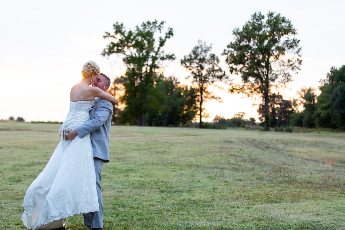 Romantic Sunset Fall Elopement  bride and groom in field  at Kokopelli Golf Club  in Southern Illinois  by Amy Britton Photography Photographer in St. Louis