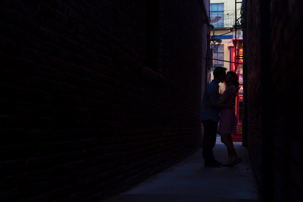 Silhouette portrait of couple in Victoria Chinatown