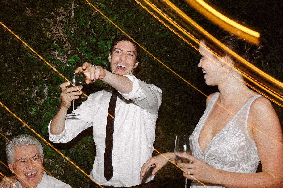 man toasting smiling at Italian wedding reception