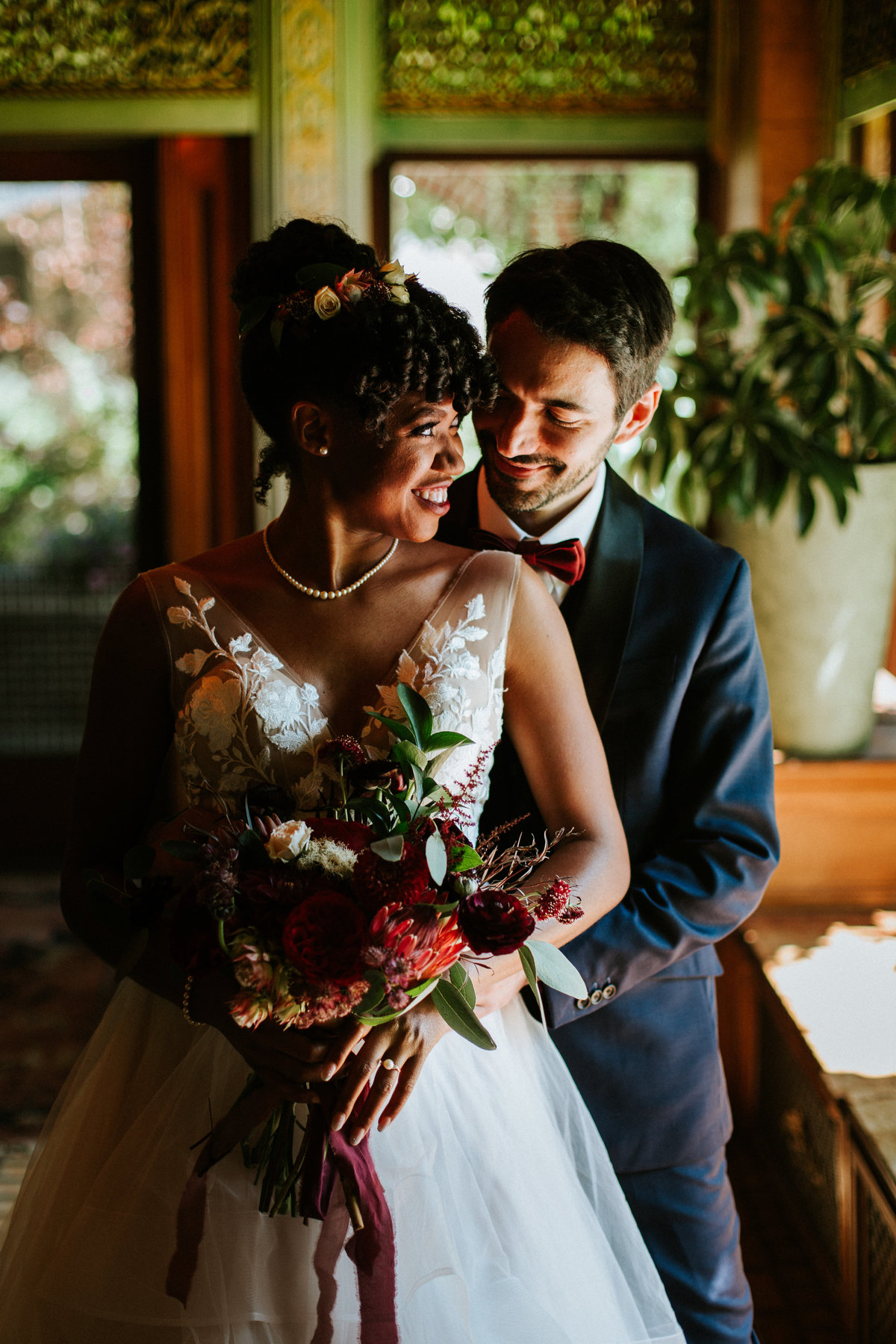 One of the top wedding photos of 2019. Taken by Adore Wedding Photography- Toledo Ohio Wedding Photographers. This photo is of bride and groom laughing after the wedding ceremony