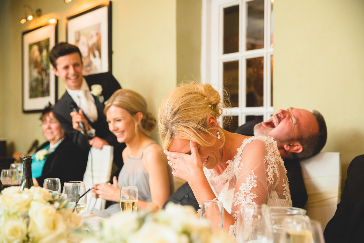 head table laughing in the speeches
