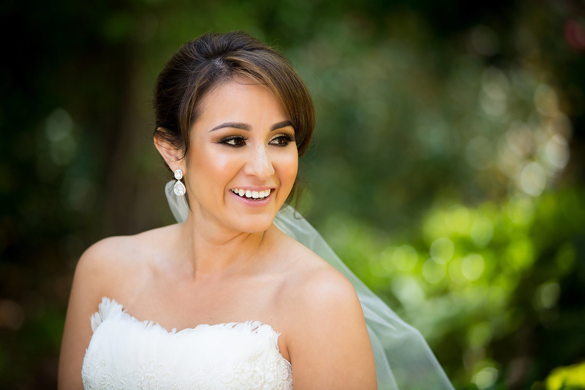 Twin Oaks wedding photos bride smiling with veil blowing