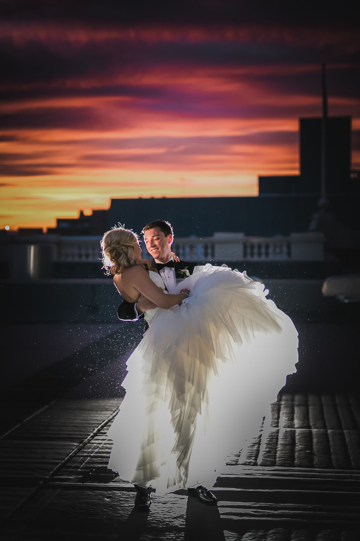 lifting-up-bride-rooftop