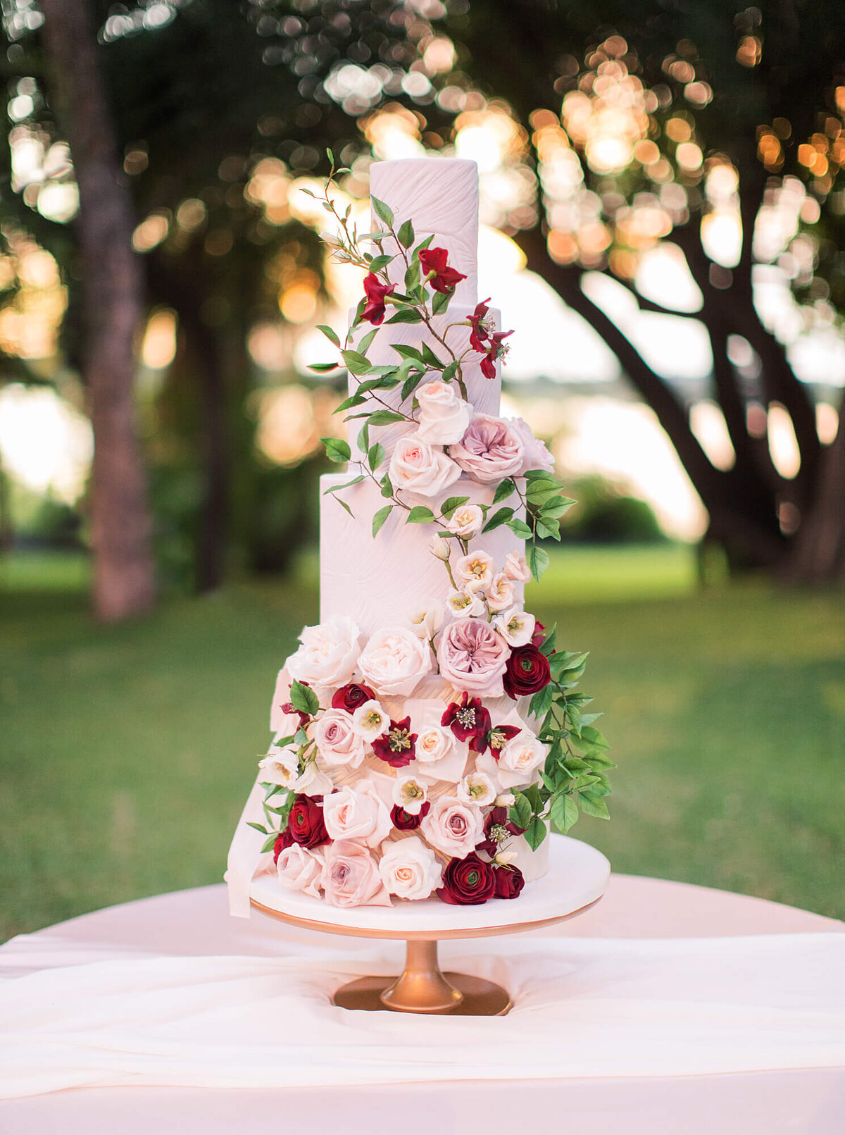 4 tier blush pink and red luxury wedding cake  royal livingstone Zambia | MonAnnie