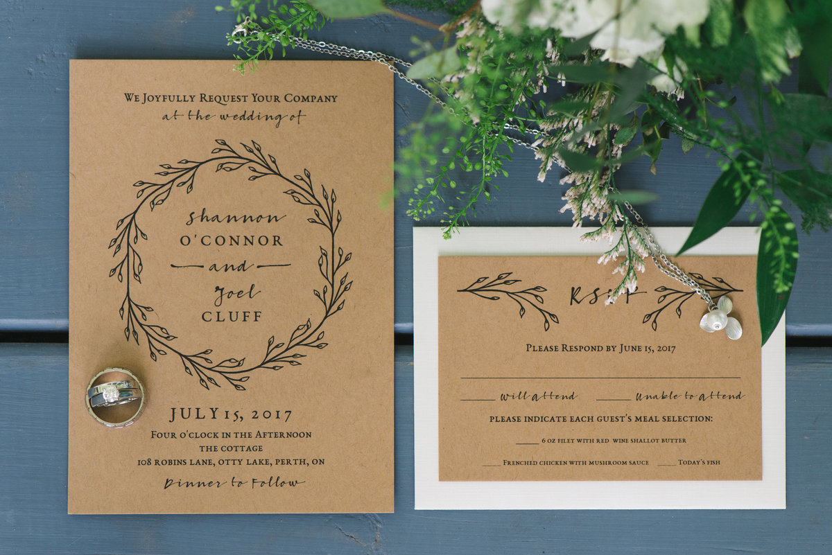 kraft paper invitation suite with wedding rings and bouquet