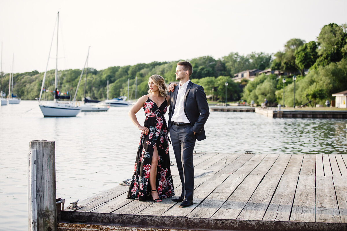 Engaged couple standing on dock of Buffalo Outer Harbour, New York