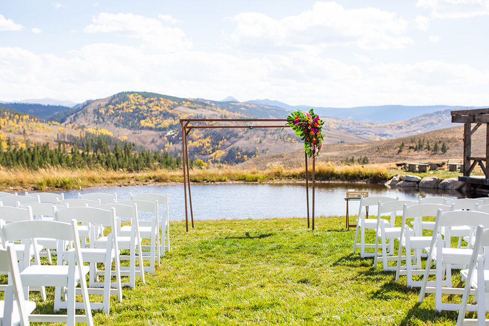 granby-colorado-Strawberry-Creek-Ranch-Wedding-Ashley-McKenzie-Photography-tropic-meets-mountain-wedding-colorful-altar