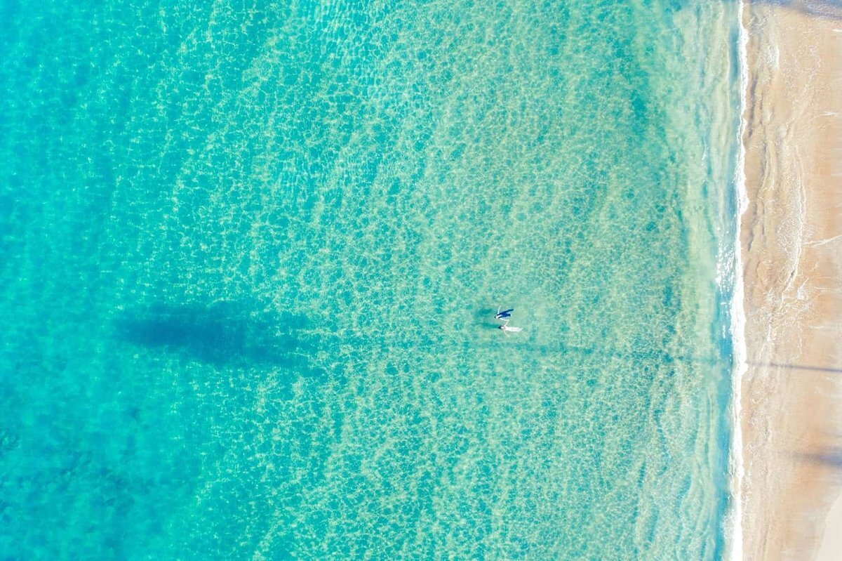 Husband and wife photographed by drone during their Maui honeymoon