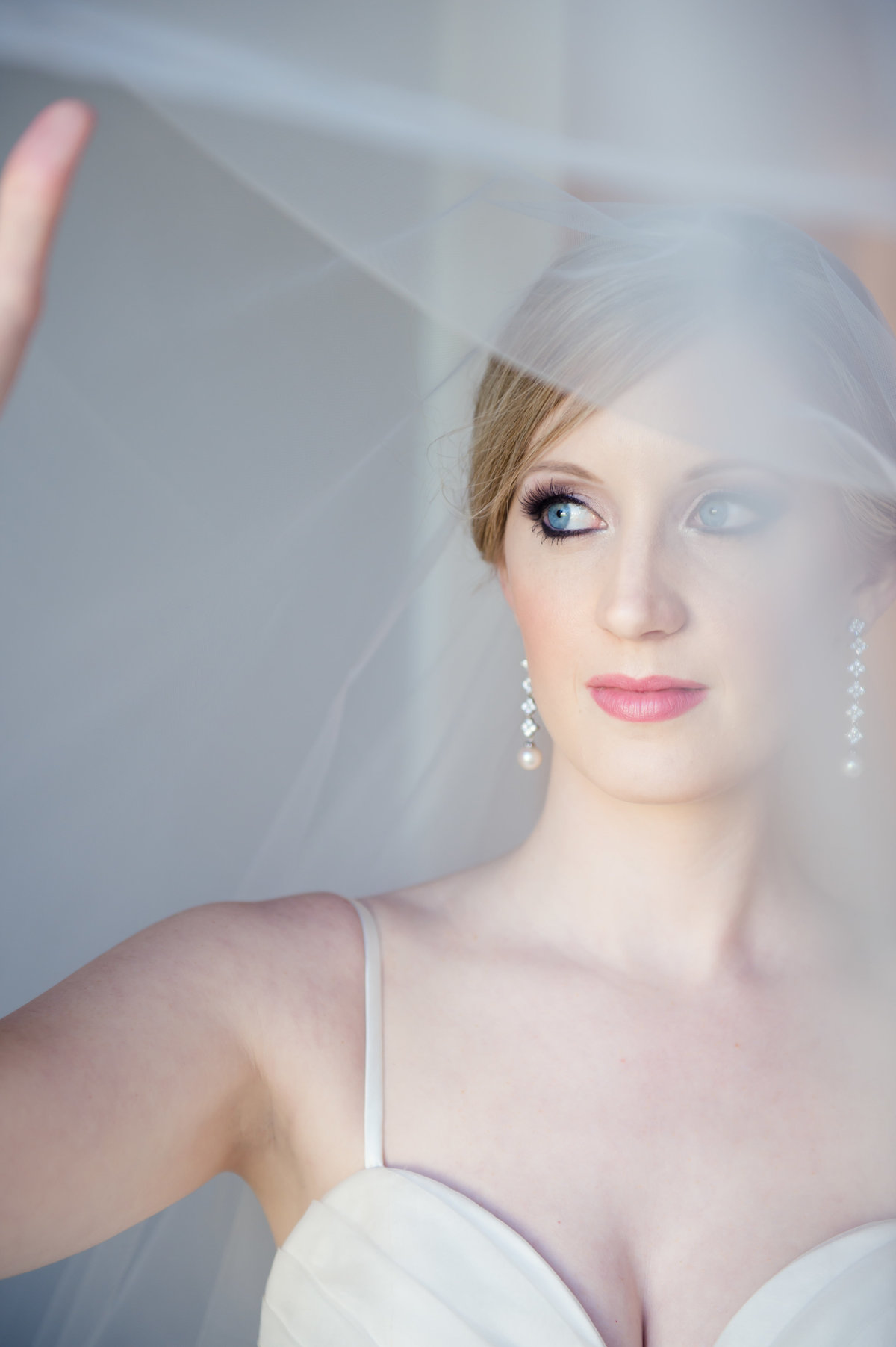 Bride holding veil by Brittany Barclay Photography