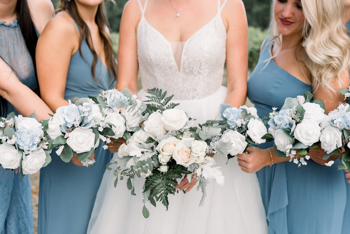 Bride with bridesmaids holding flowers at Maryland winery wedding