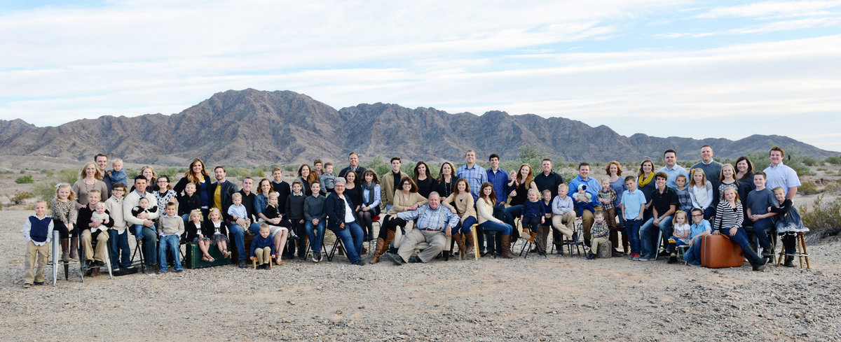 extended family portrait with mountains