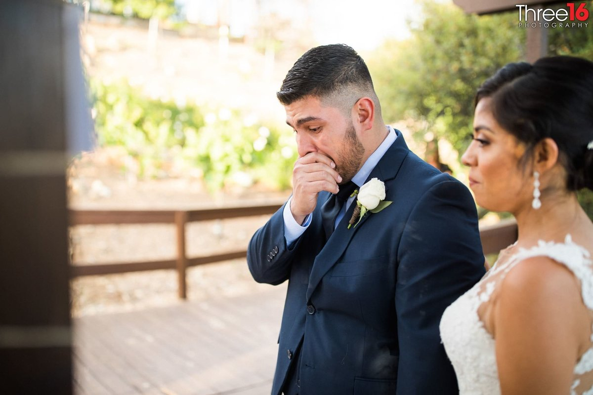 Groom holds back tears during his wedding ceremony