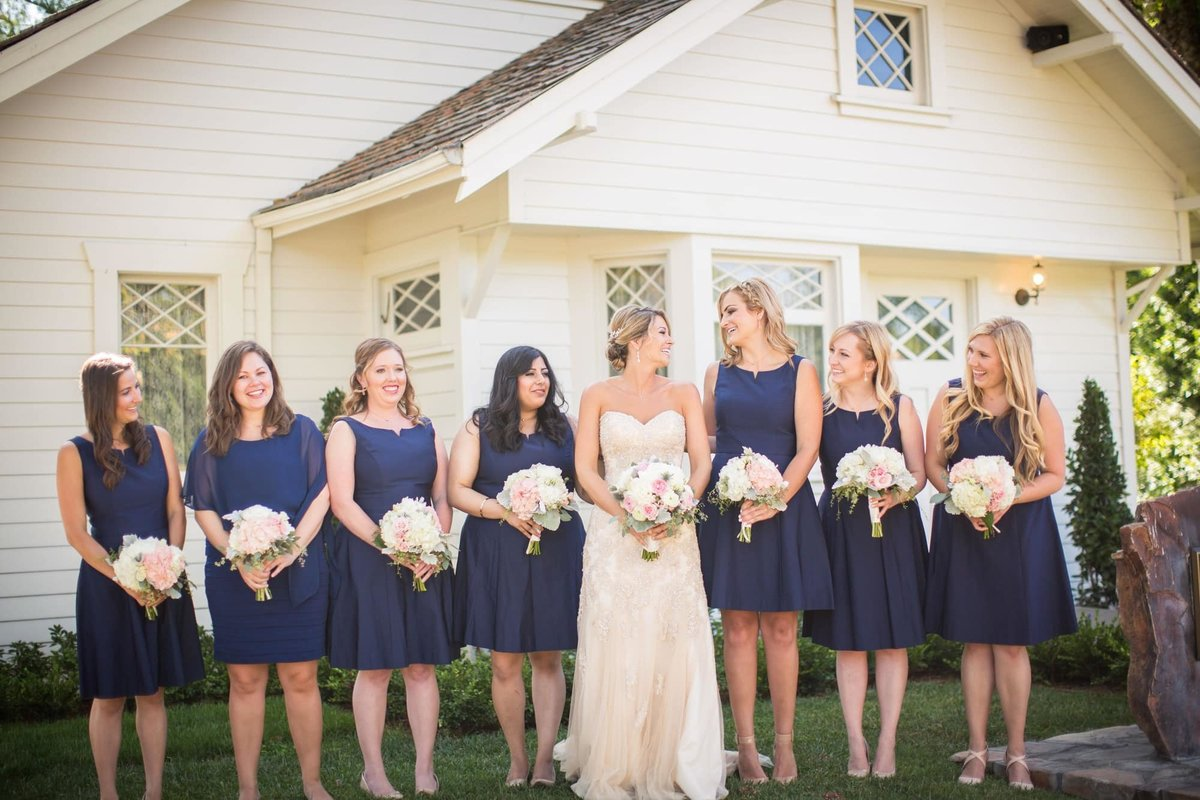 Navy Blue dressed Bridesmaids pose with the Bride in front of Richard Nixon's birth home