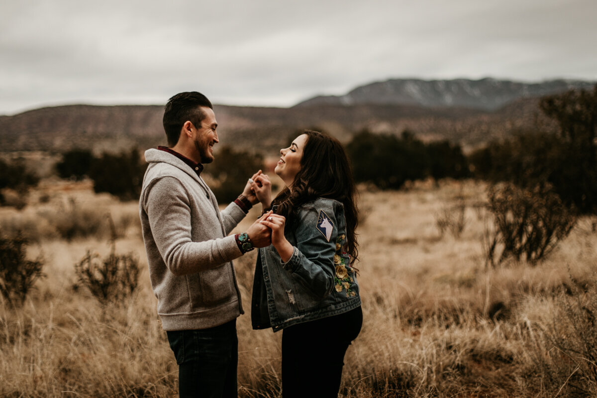 man and woman dancing in New Mexico desert