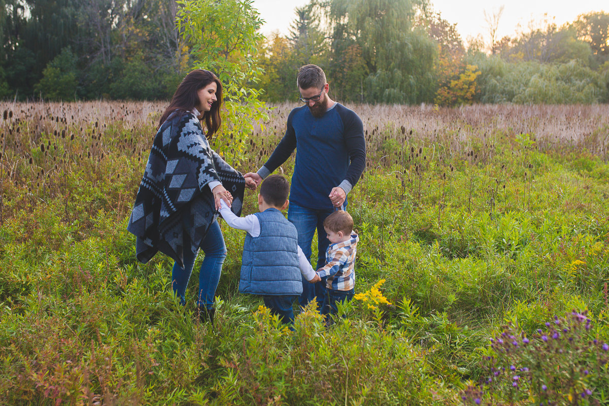 Family of four twirling in the fields {Milton Family Photographer}