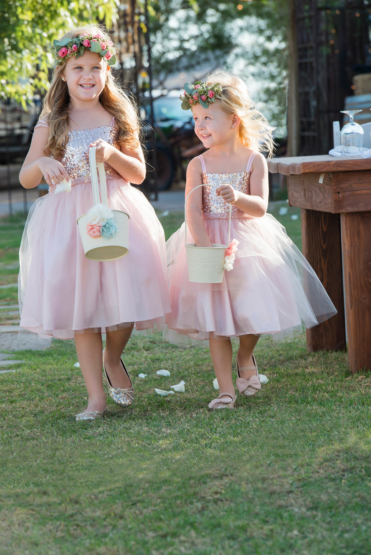 Flower girls during ceremony at From the Farm in Yuma AZ