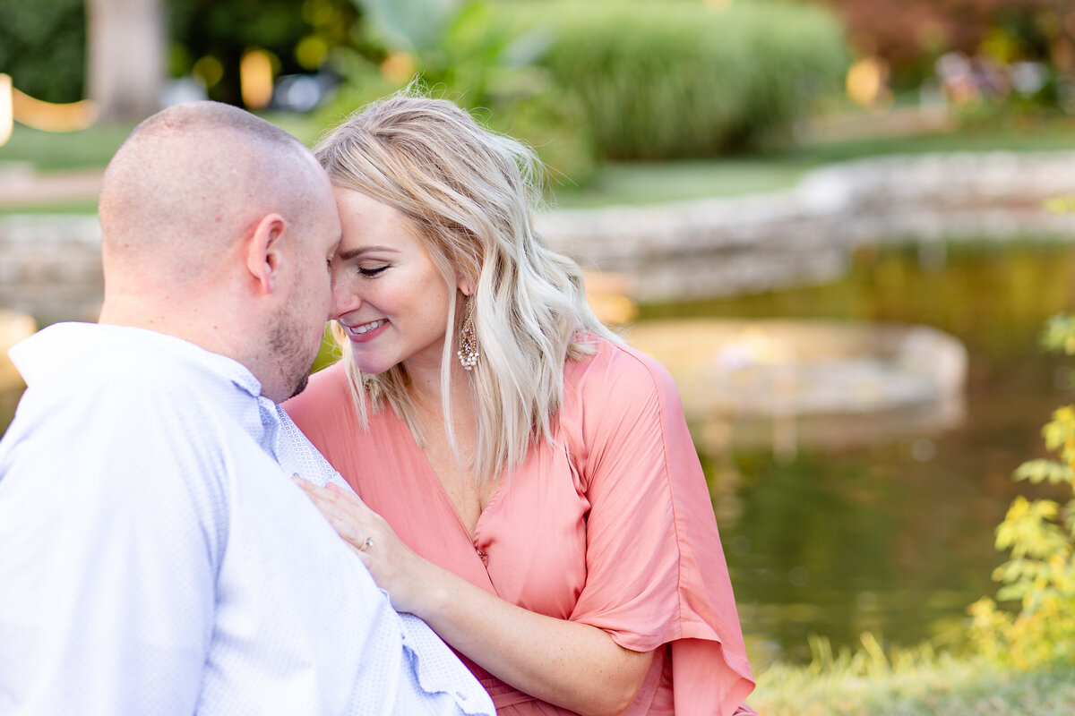 Summer Sunset Engagement Session with pink maxi dress couple  by water  in Tower Grove Park in St. Louis by Amy Britton Photography Photographer in St. Louis