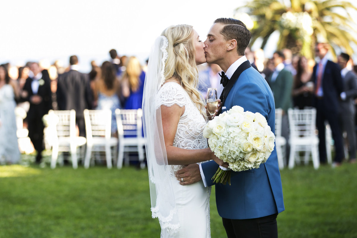 couple kiss luxury outdoor wedding ceremony santa barbara