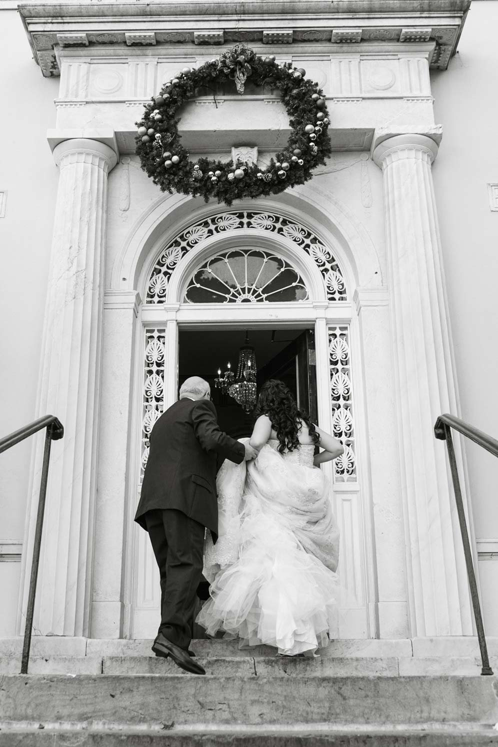 Bride walking into The Mansion at Oyster Bay
