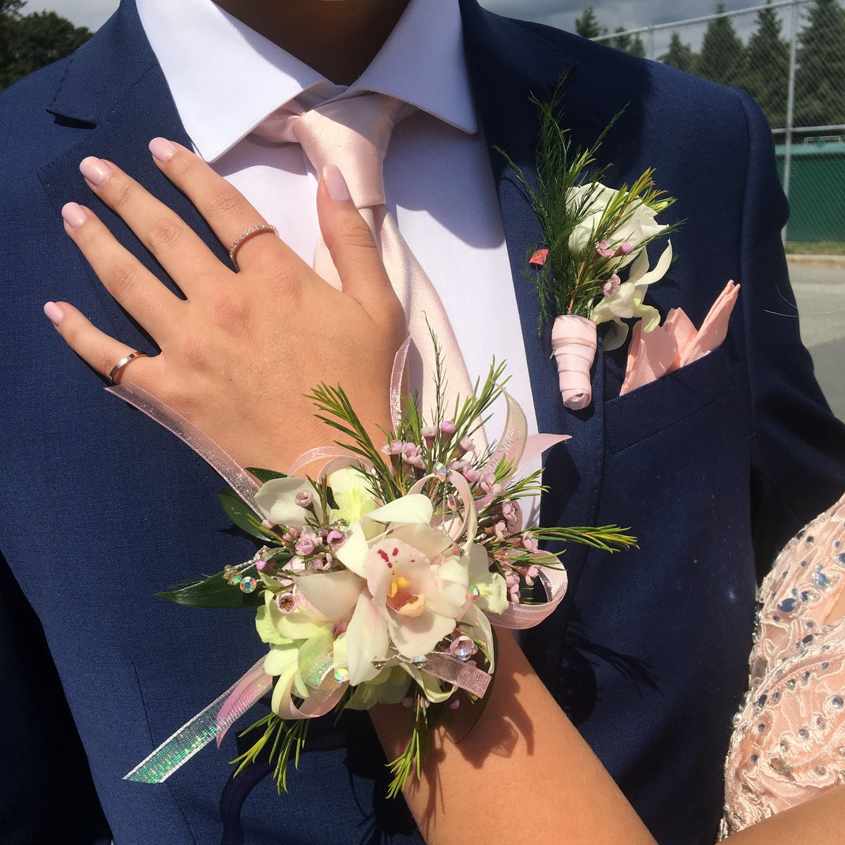 Cymbidium Prom corsage and matching boutonniere