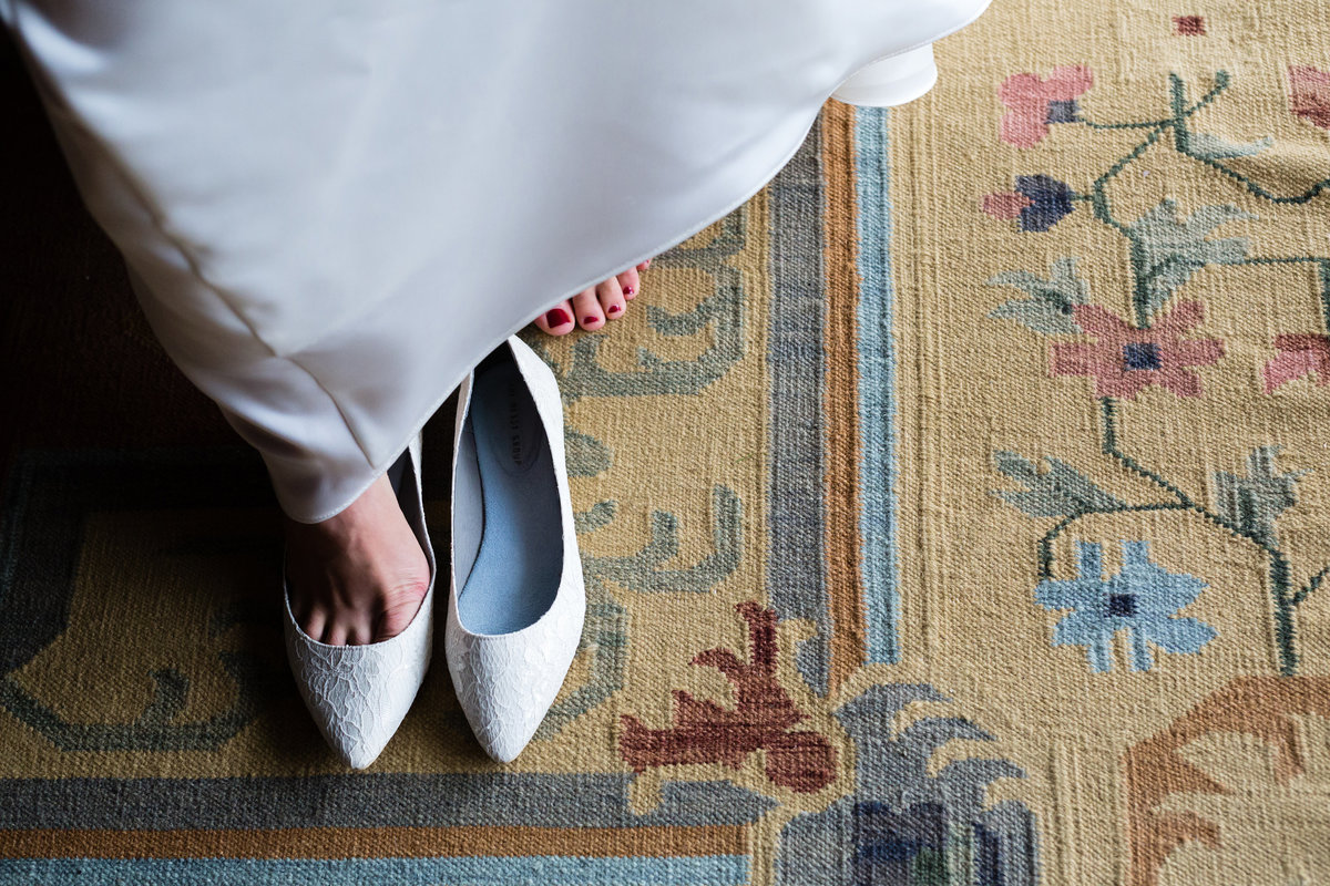 The bride gets into her wedding day shoes at Clarks Cove Farm in Maine