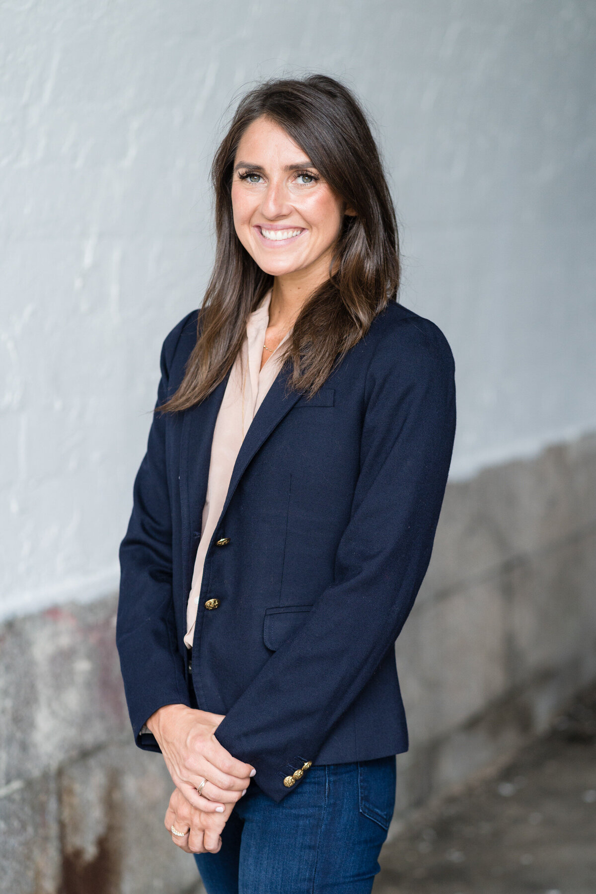 woman in a business jacket smiling