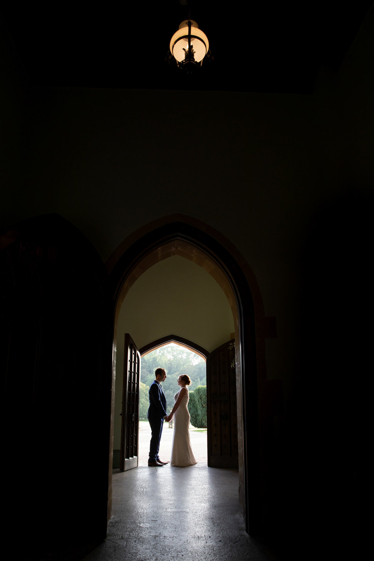 Wedding couple stood in the doorway at St Audries Park Wedding Venue in Somerset