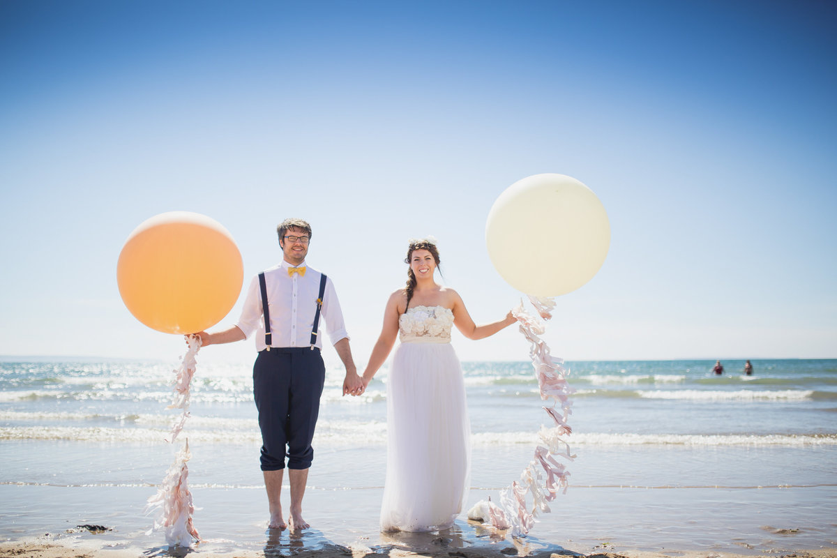 bride and groom with the giant balloon company