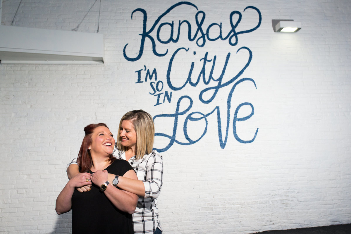 same sex engagement photo downtown kc