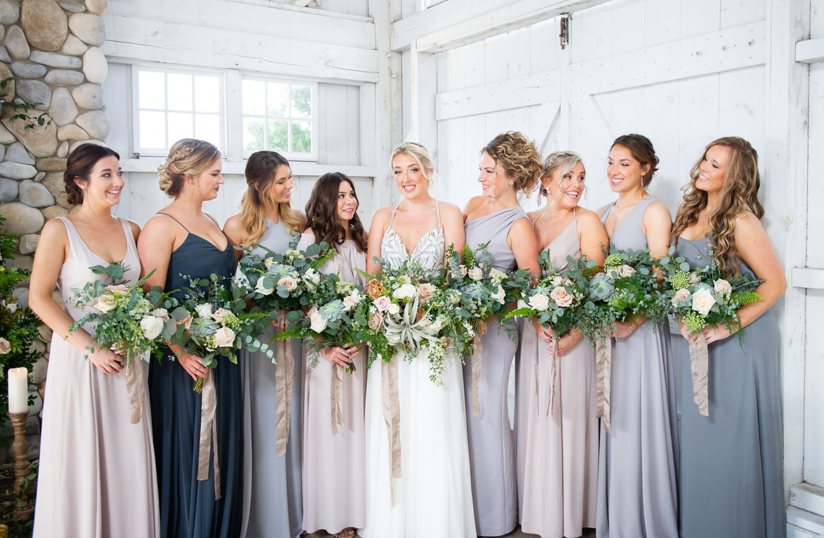 bridesmaids in different shades of blue at bonnet island