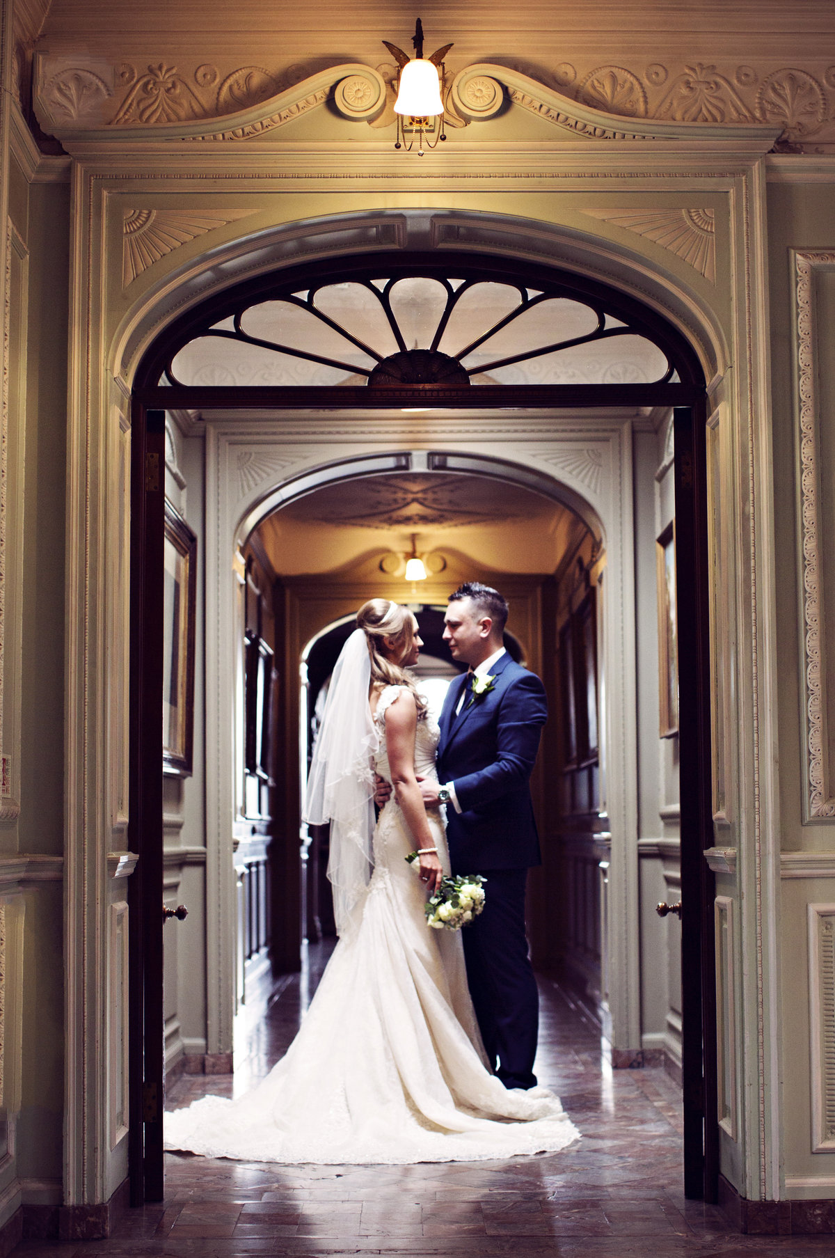 A bride and groom in the halls of Thornton Manor
