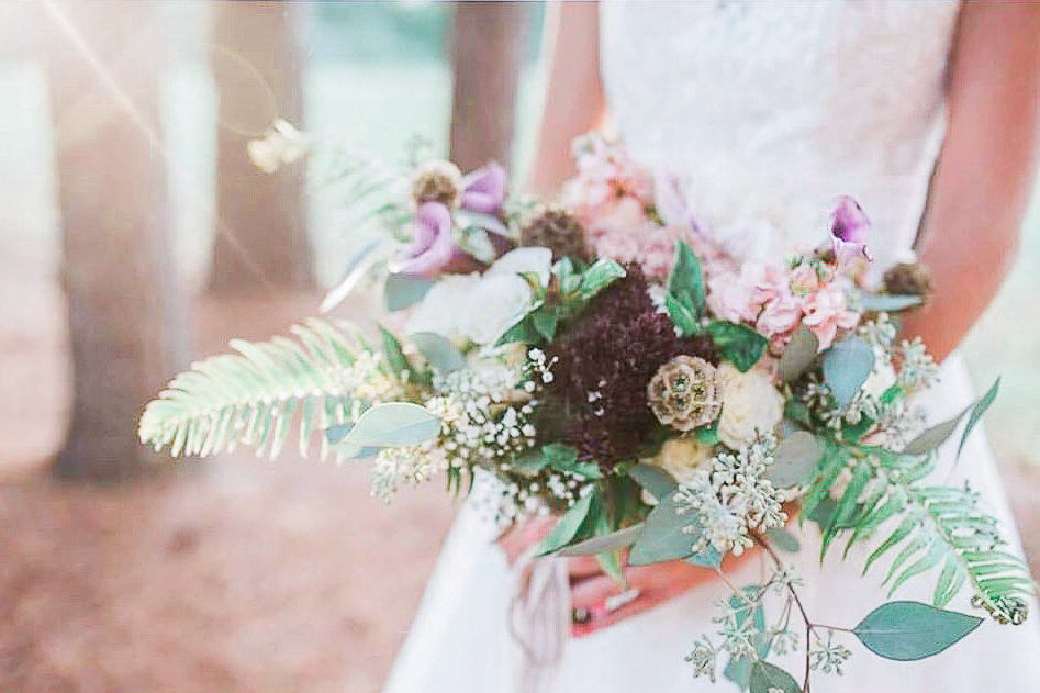 beautiful unique rustic wedding bouquet with lots of textures by Northwest Arkansas wedding florist