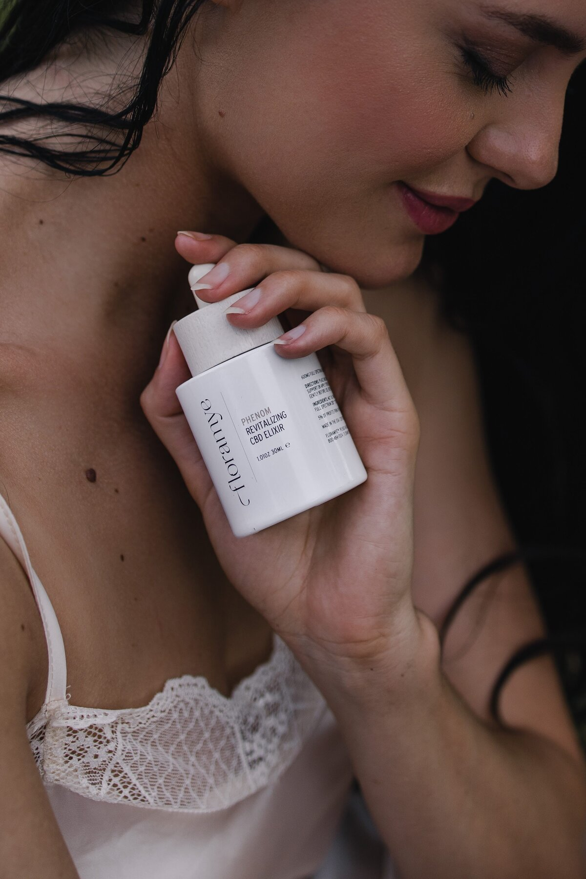 Conscious product photography of certified organic CDB Elixir by Florayme shot by Alex Perry at Lake Luisa