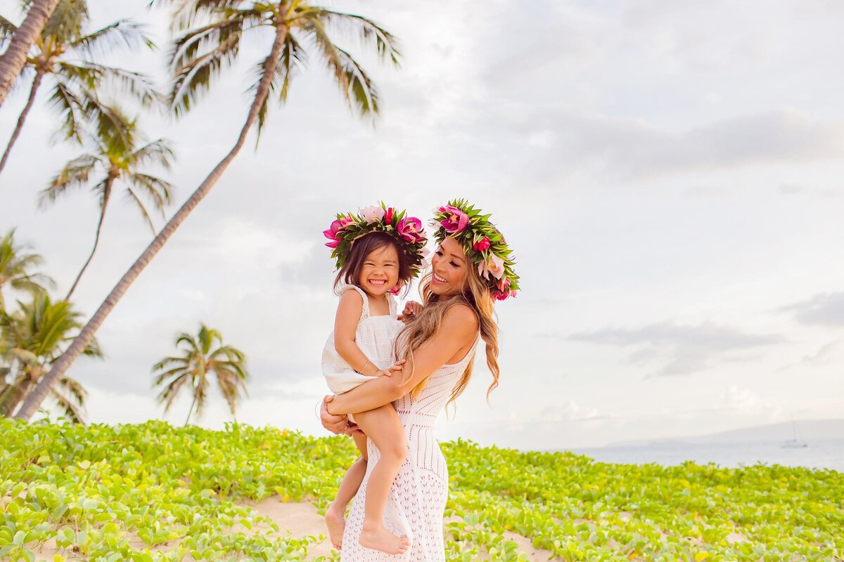 Mother and daughter wearing matching haku lei for their portrait shoot on Maui