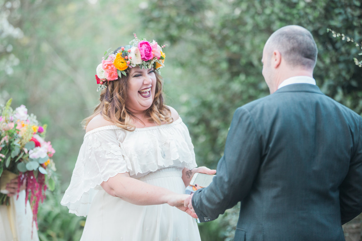 Bride laughing during ceremony at Madrona Manor in Healdsburg California