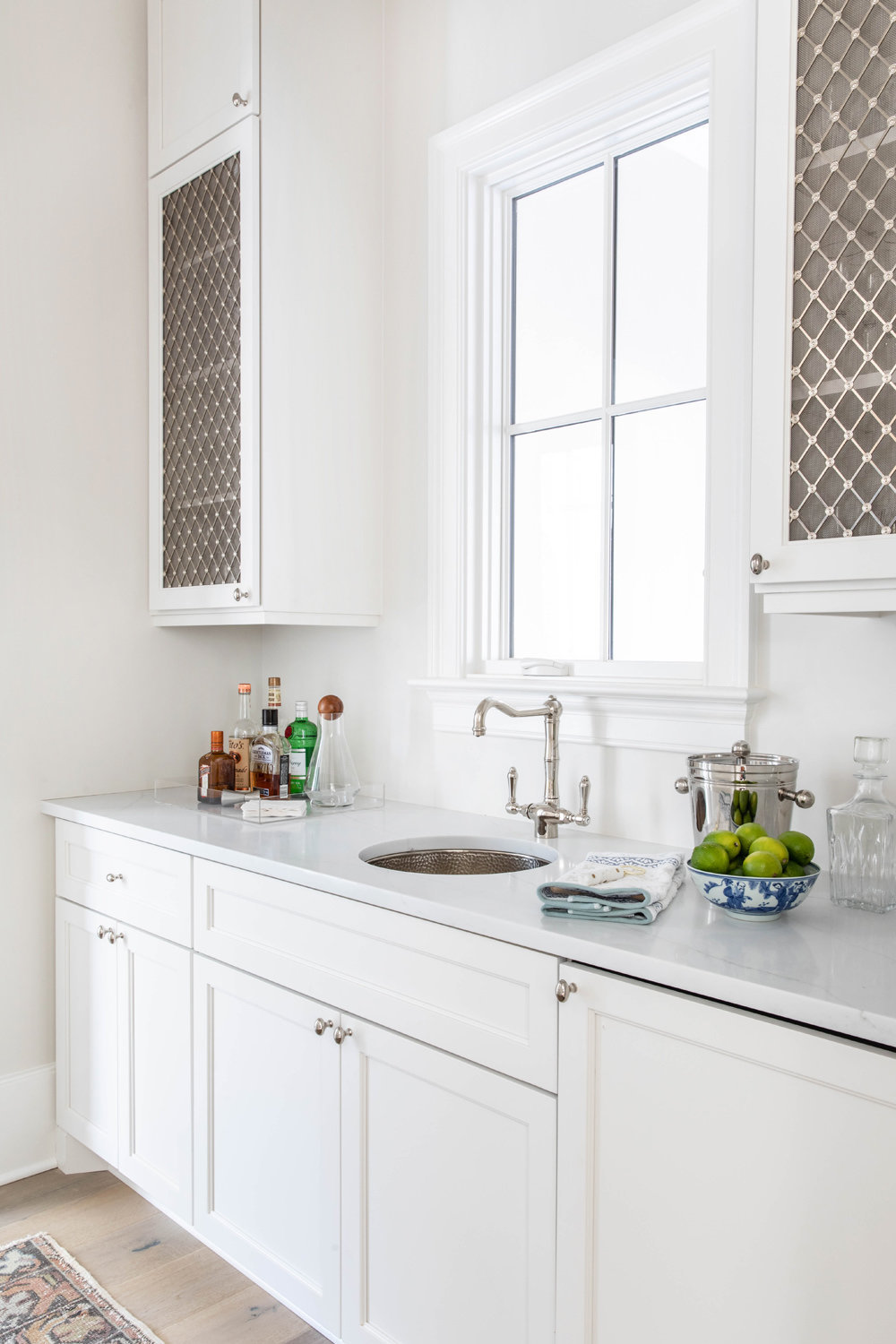 White-Inset-Cabinetry-Wet-Bar-with-Wire-Mesh-Insert-1