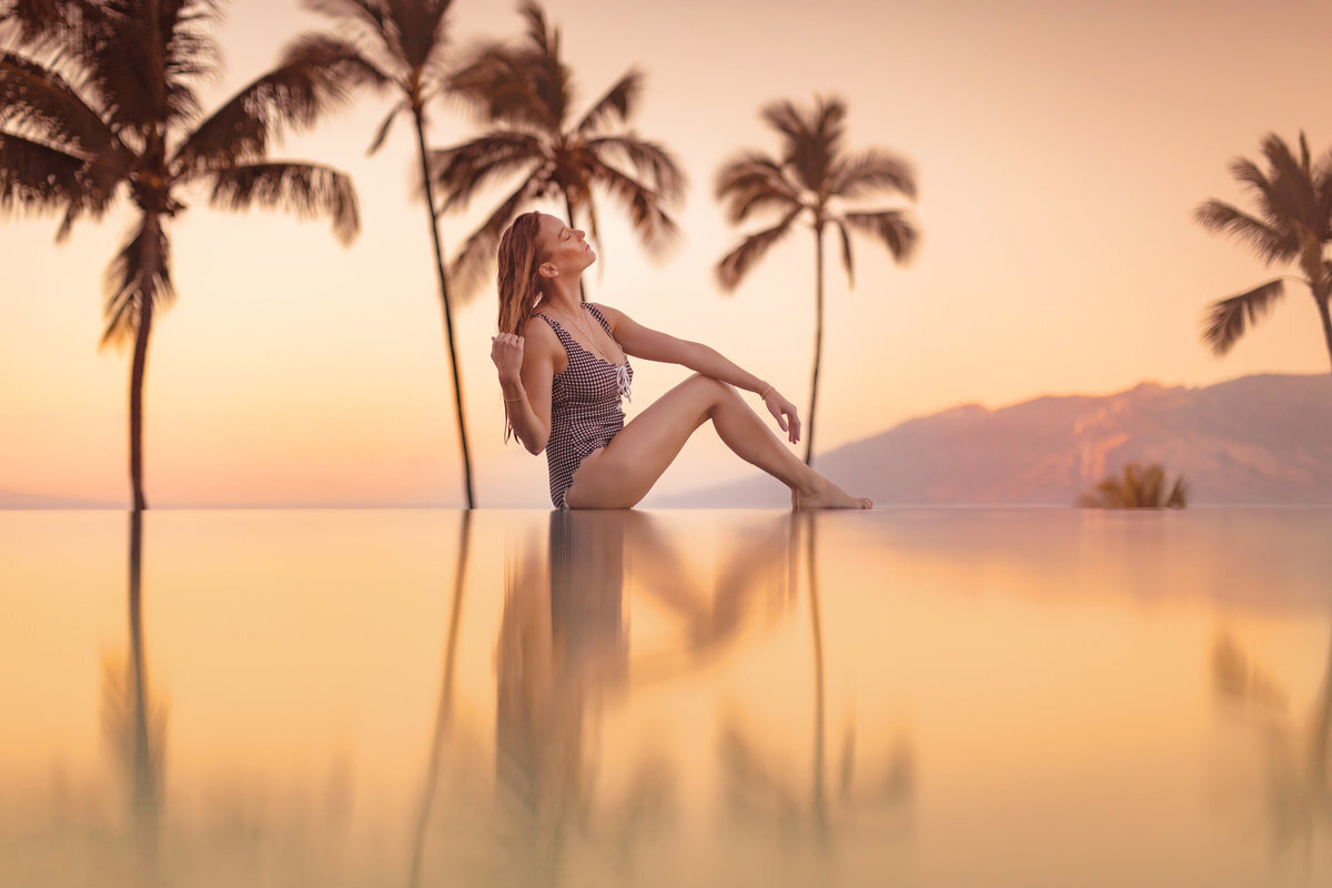 Woman poses at the infinity pool at the Four Seasons Resort Wailea on Maui