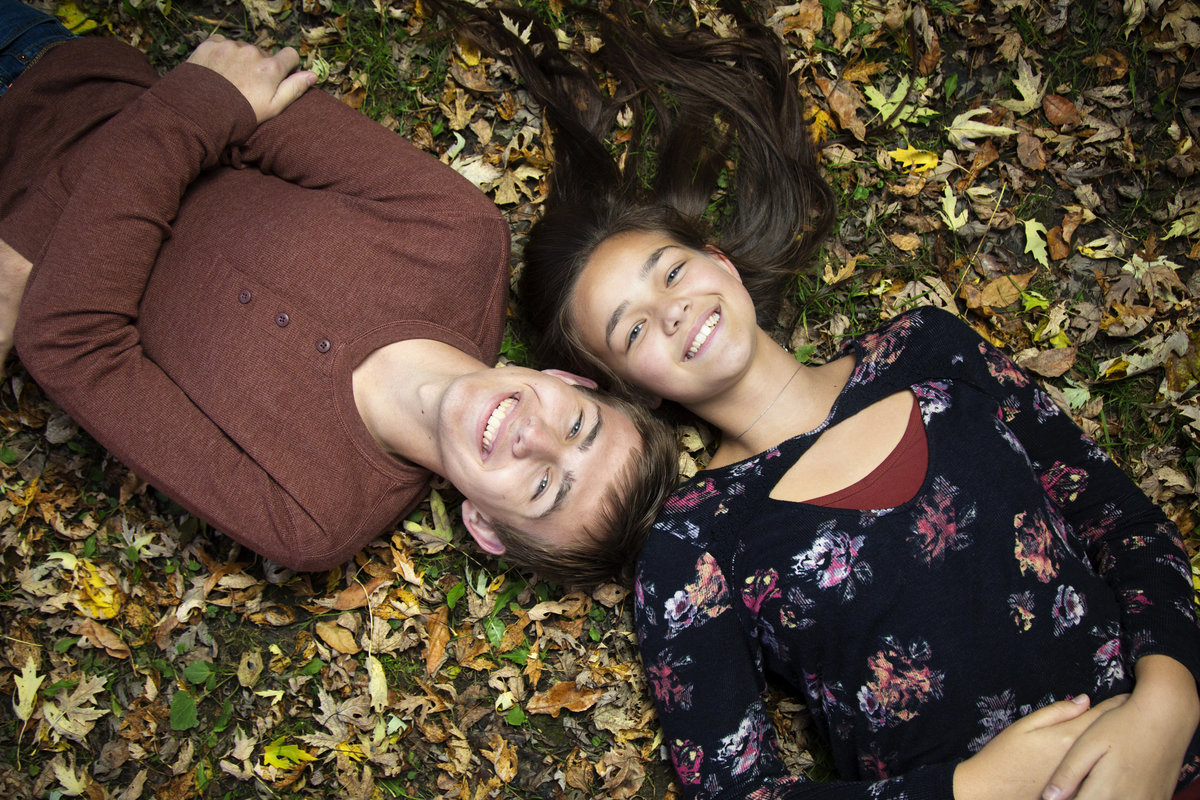 sioux falls family photography brother and sister autumn leaves south dakota