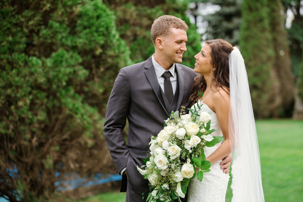 photo of bride and groom smiling and looking at each other from wedding at The Carltun