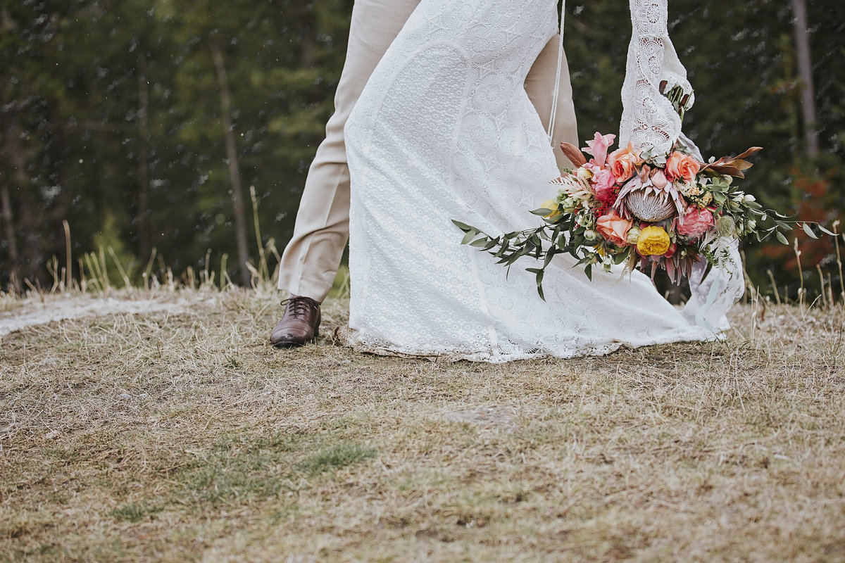 Delical Bridal wedding dress and Fabloomosity floral bouquet at Buffalo Mountain Resort