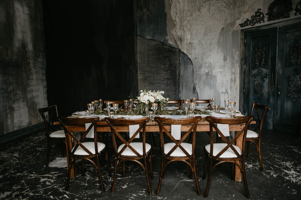 harvest table. harvest chairs, in moody grey and blue atmosphere