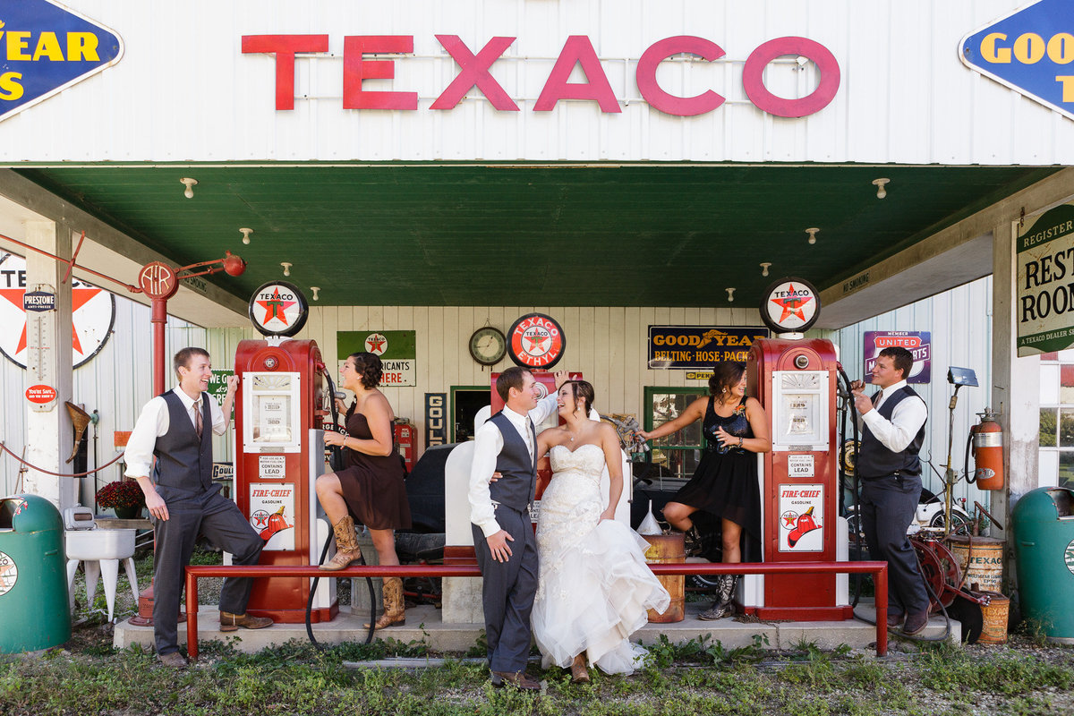 antique gas station decor at this texaco mock station for the wedding day