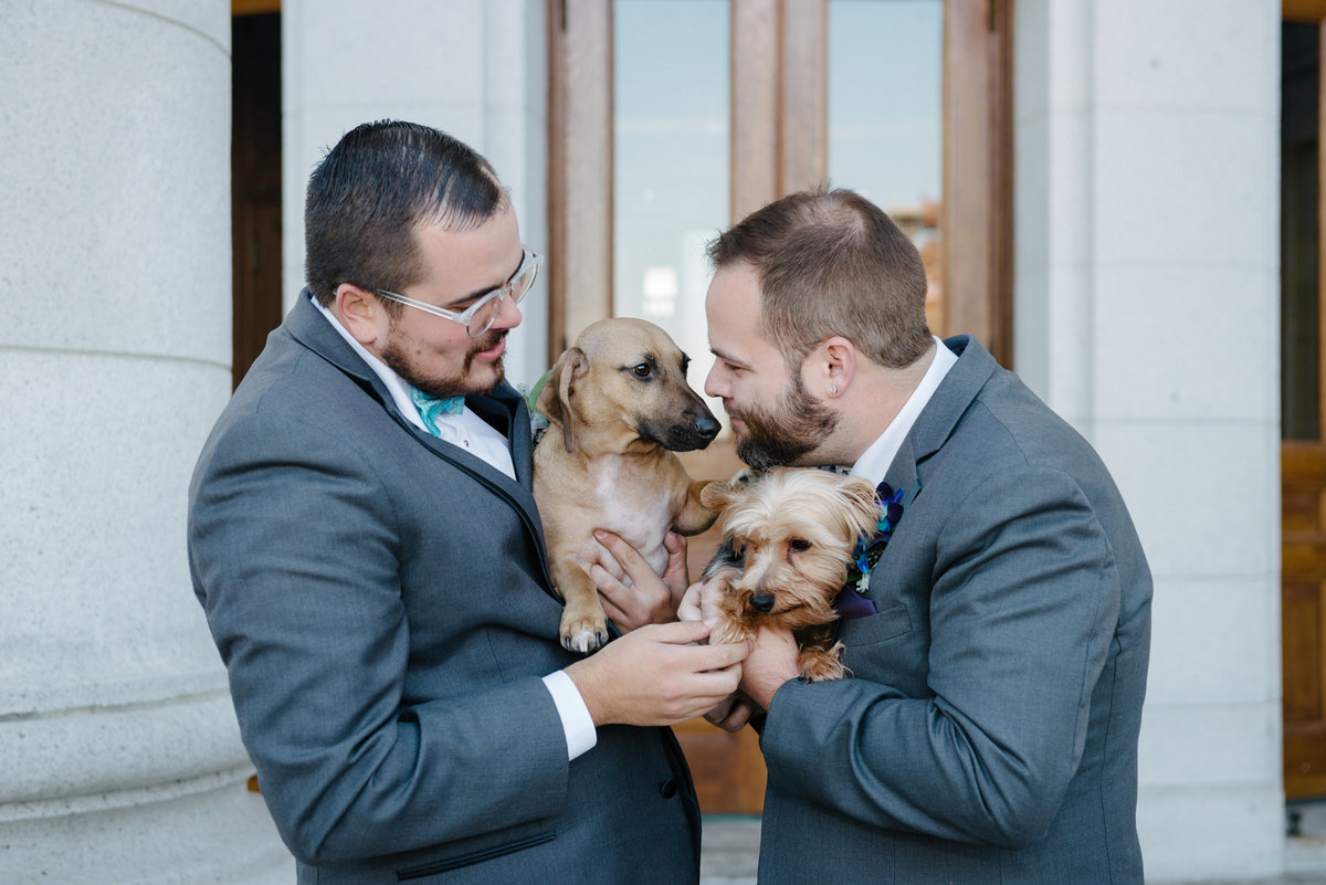 two grooms with dogs