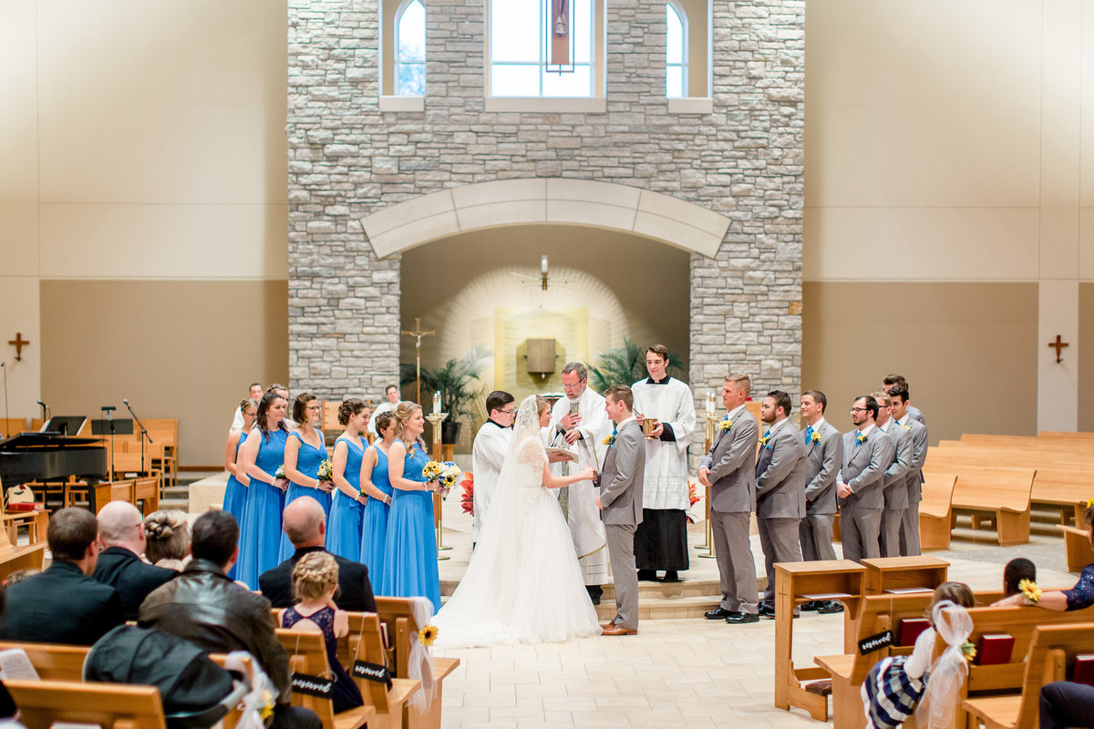 Catholic wedding photos - vows at Saint Peter's in Mendota Heights