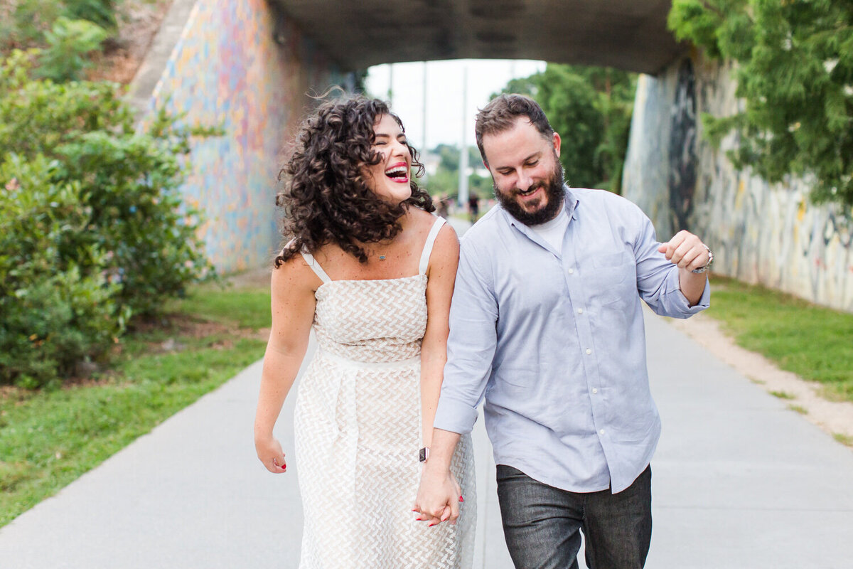 joyful happy engaged couple on the atlanta beltline