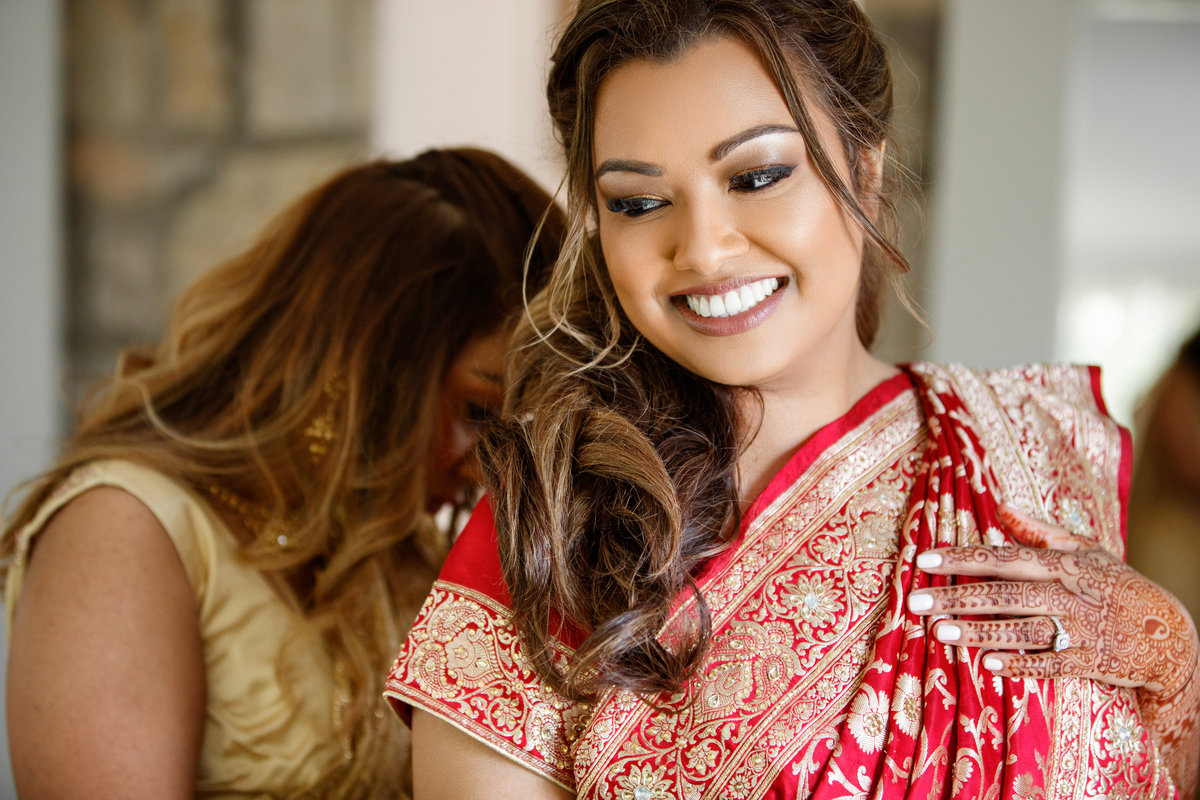 Indian wedding photographer pecan springs ranch bride gets ready traditional dress ring 10601 B Derecho Drive, Austin, TX 78737